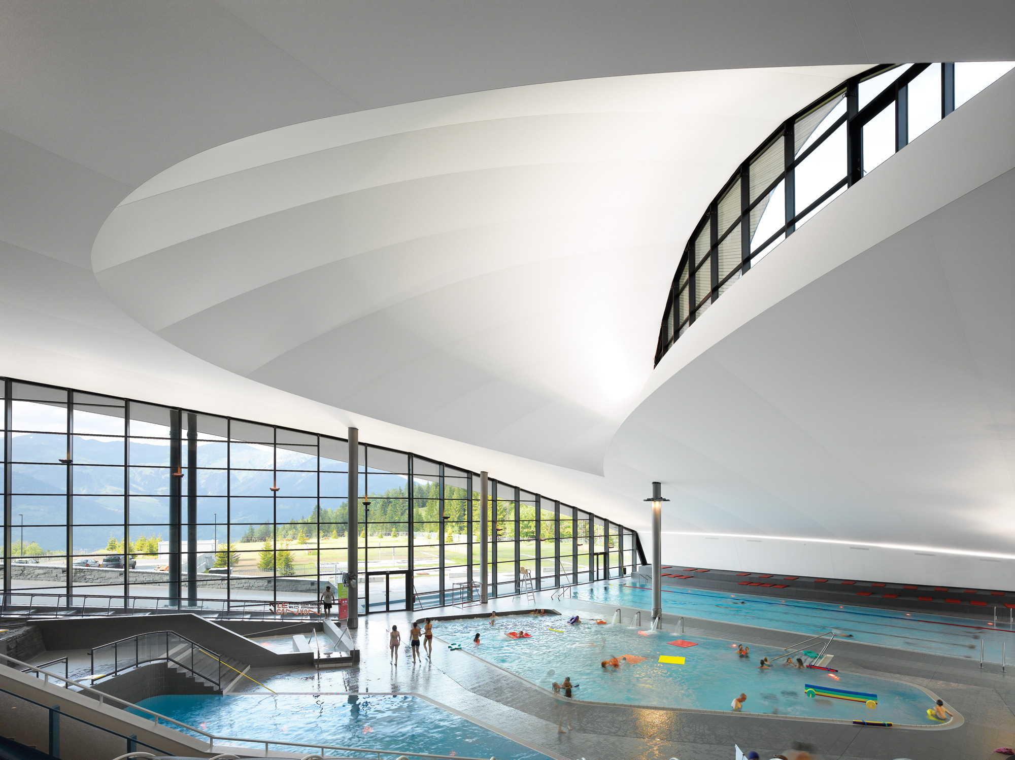 Moritz auer adds impressive aquatic center to french ski for Pool design education