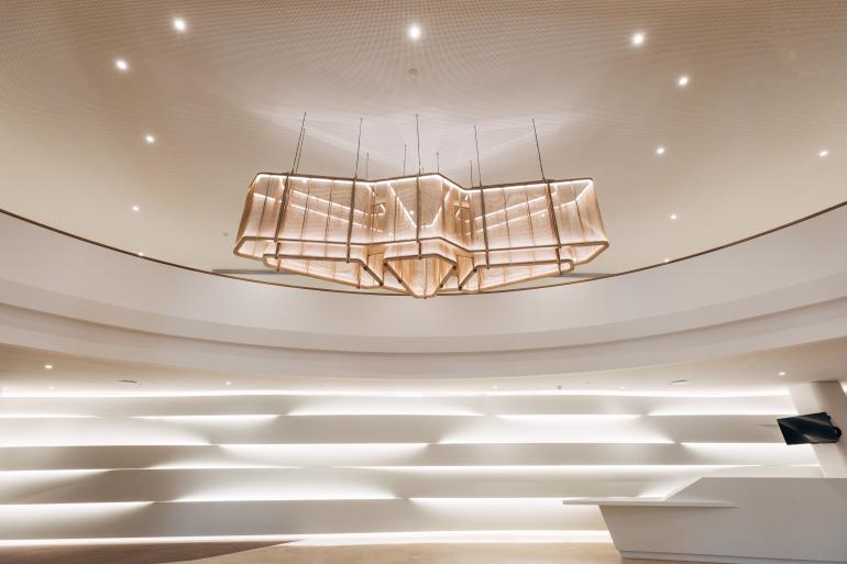 Innovative metal mesh chandelier graces grand parisian lobby aloadofball Image collections