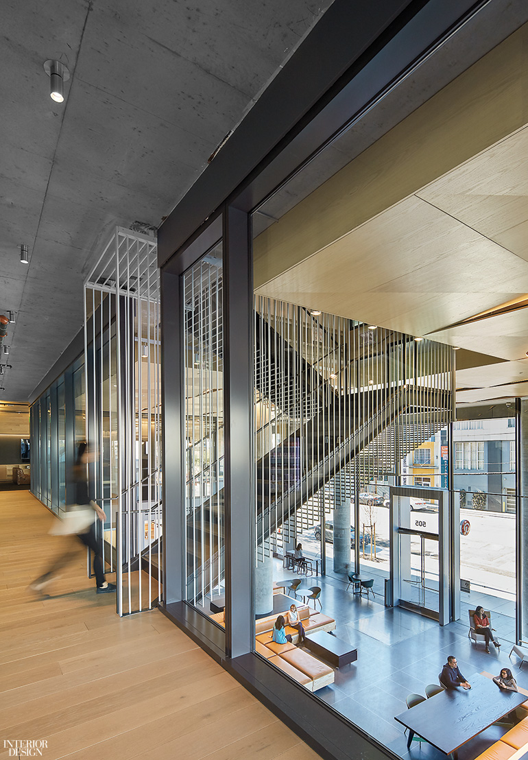 Perforated oak panels and concrete compose the ceiling plane photography by bruce damonte