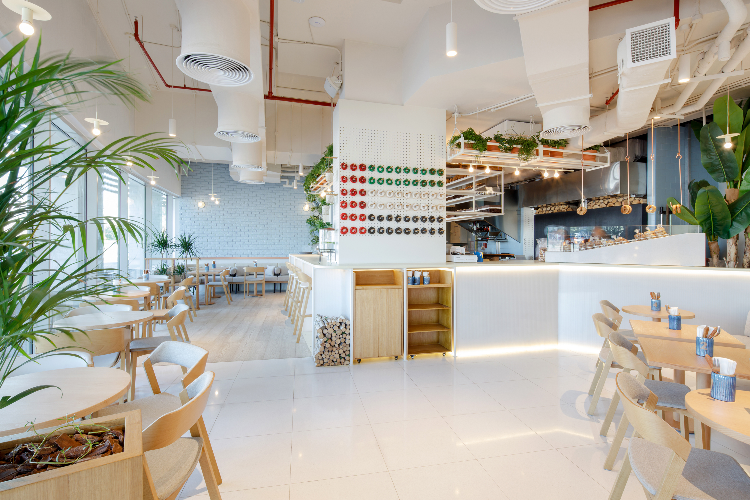 H2r Design Creates Pegboard Inspired Bagel Yard Café In Dubai