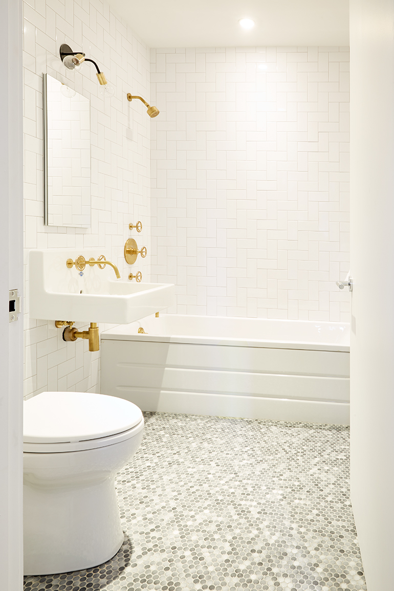 Subway and penny tiles from lazer marble clad a second full bathroom with a toto toilet photography by cheng lin