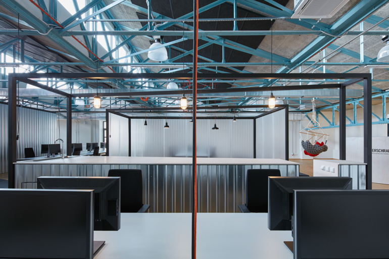 Open Workspaces Include LUV Interior Desks Illuminated By Pendants From The  Bohemian Company; A Stand Up Conference Desk Behind Them Has A Custom ...