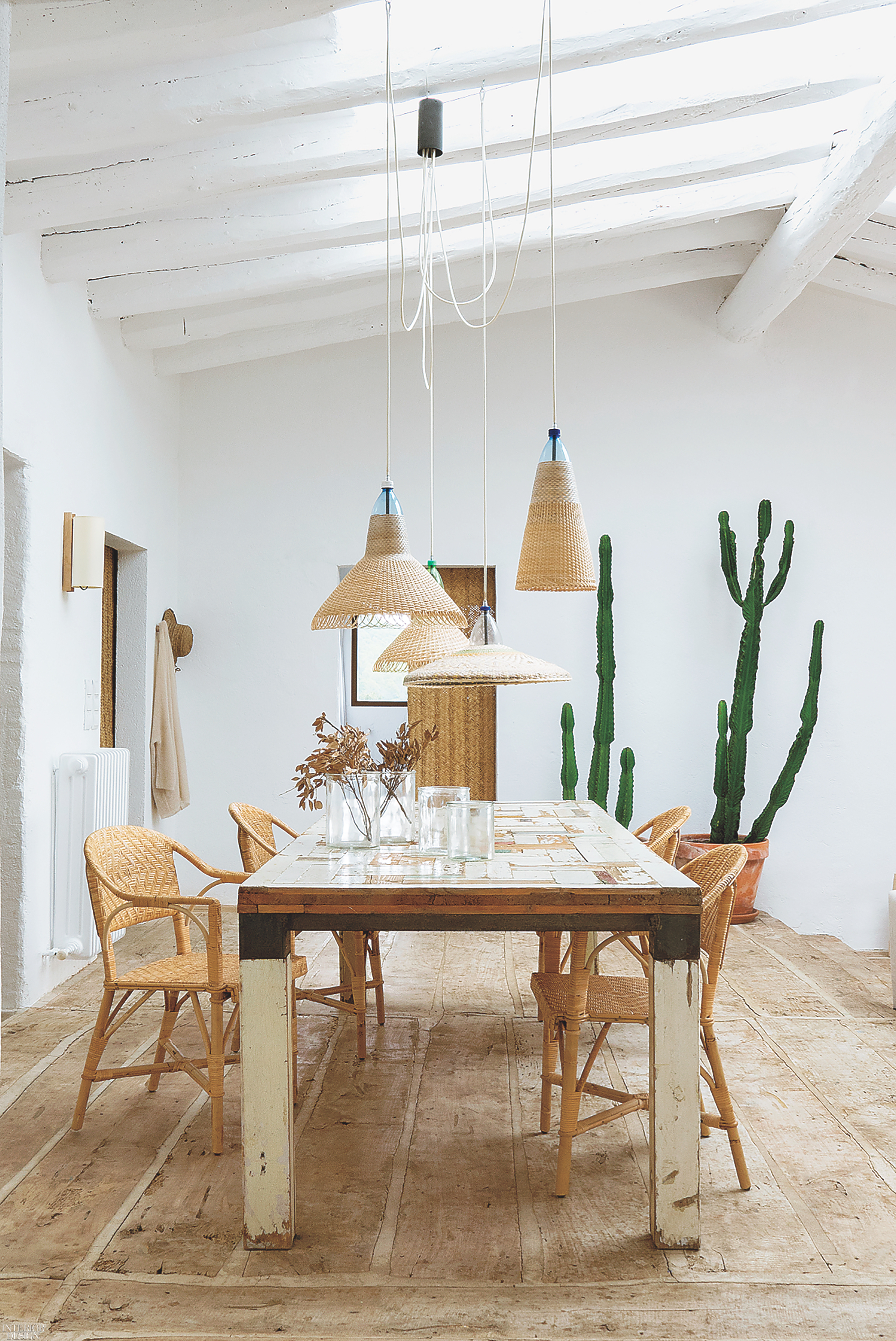 ... Into The Dining Area, Where PET Lamps By Álvaro Catalán De Ocón Dangle  Over Vintage Wicker Chairs (from A Local Maker) And A Salvaged Wood Table  By Piet ...