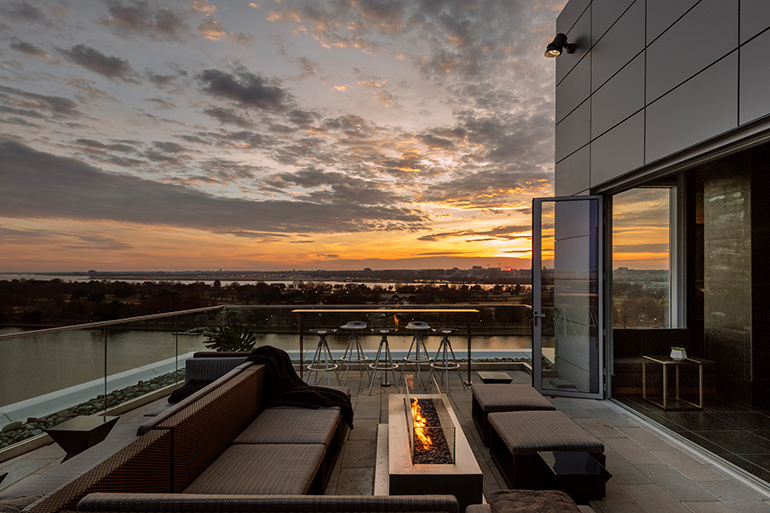 Whiskey Charlie the rooftop bar offers views of East Potomac Park and the Potomac River. Photography by Guillaume Gaudet. & Krause Sawyeru0027s Canopy by Hilton Washington D.C. Riffs on Cityu0027s ...