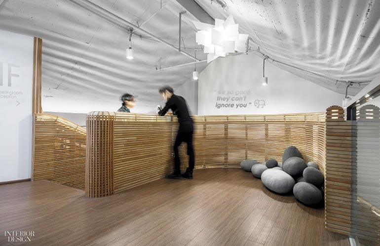 Ottomans in wool felt populate the landing  Photography by Wang Jin and  Wang Ting. Office   Interior Design Projects