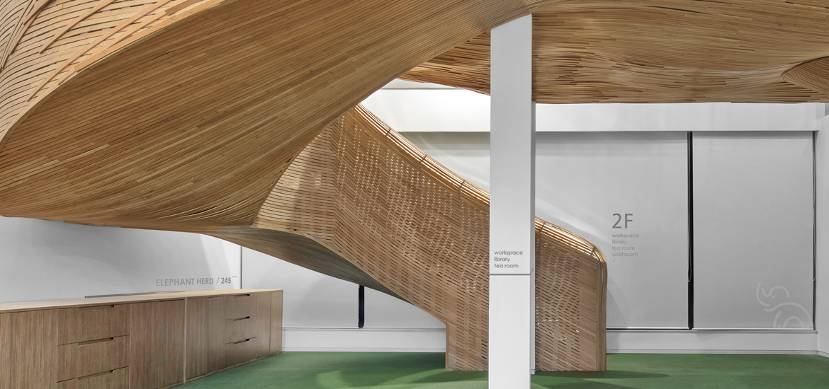 Mammoth bamboo staircase defines elephant parade s beijing for Cloud kitchen beijing