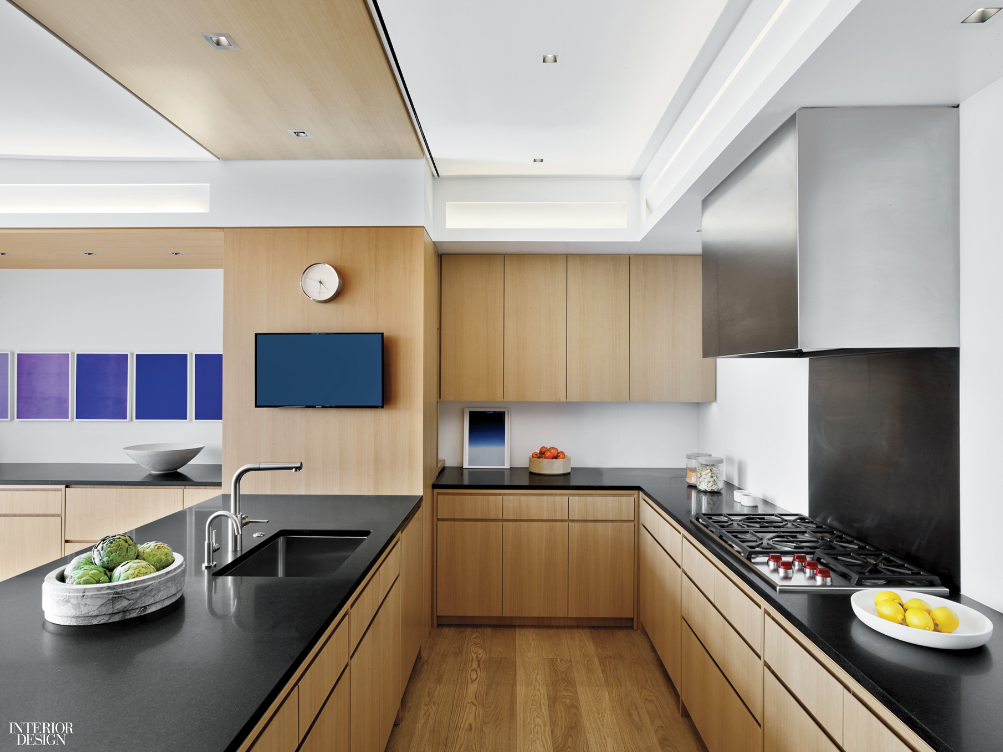 Absolute black granite countertops and polaroids by lisa oppenheim accent the kitchen photography by eric laignel