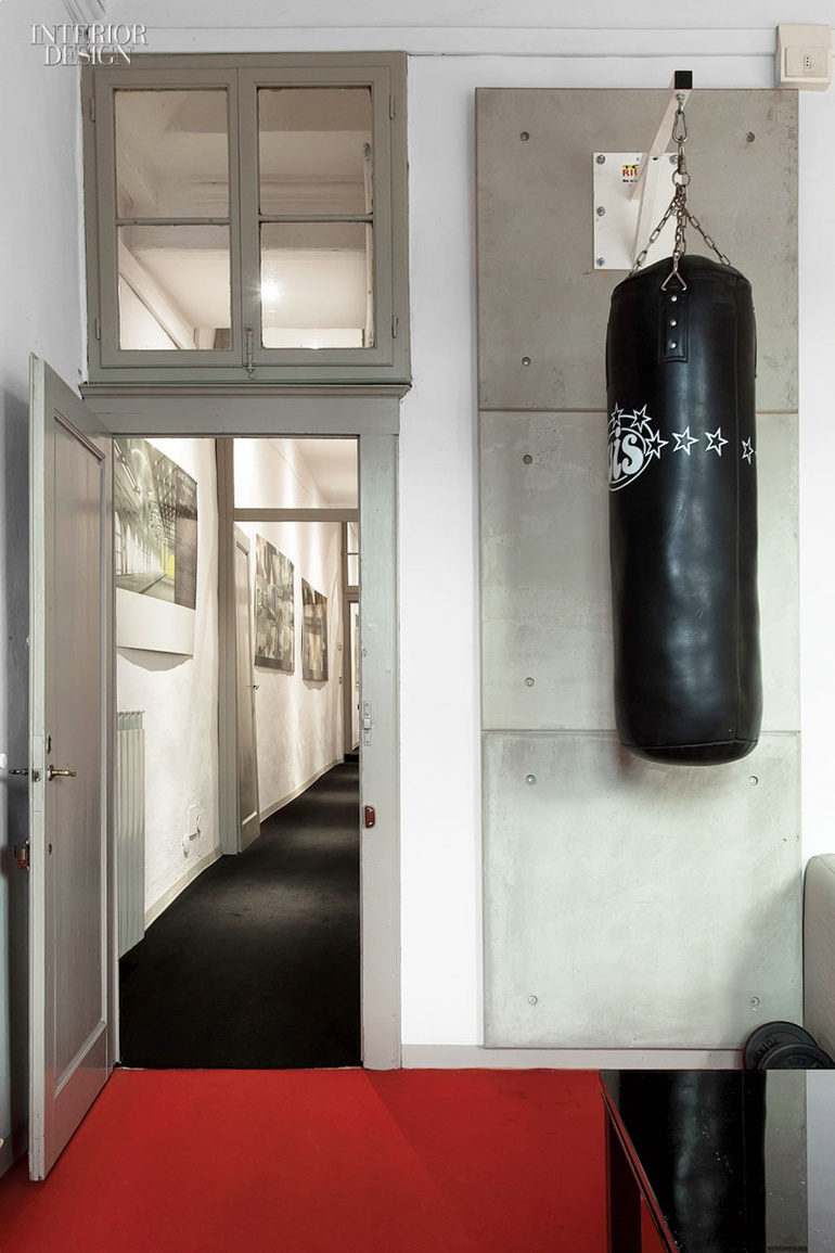 In The Principalu0027s Office, A Punching Bag Hangs In Front Of Custom Concrete  Panels. Photography By Francesca Anichini.