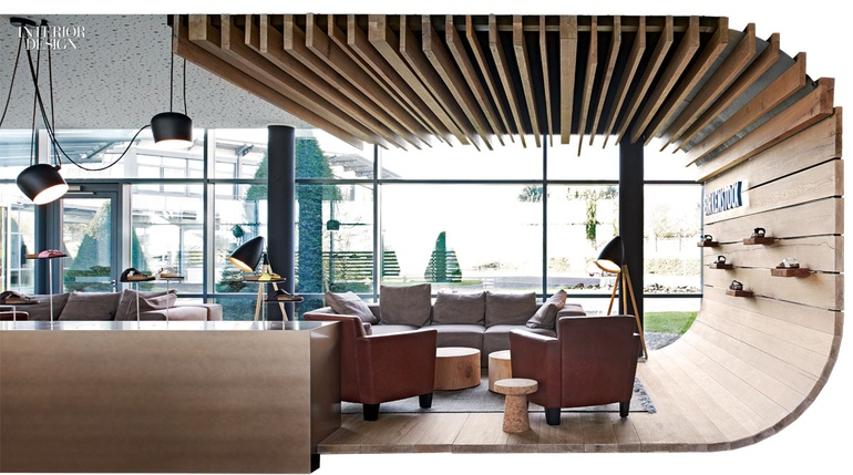 4ff0c65a998f Oak planks form a lounge raised above the slate floor. Photography by Joachim  Grothus.