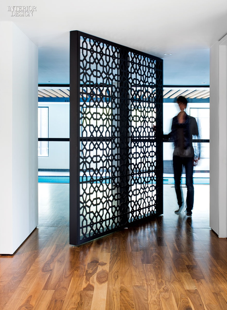 A Custom Screen In Laser Cut Powder Coated Steel Pivots 360 Degrees To Provide Access The Houses Gym And Indoor Pool Photography By Steve Tsai