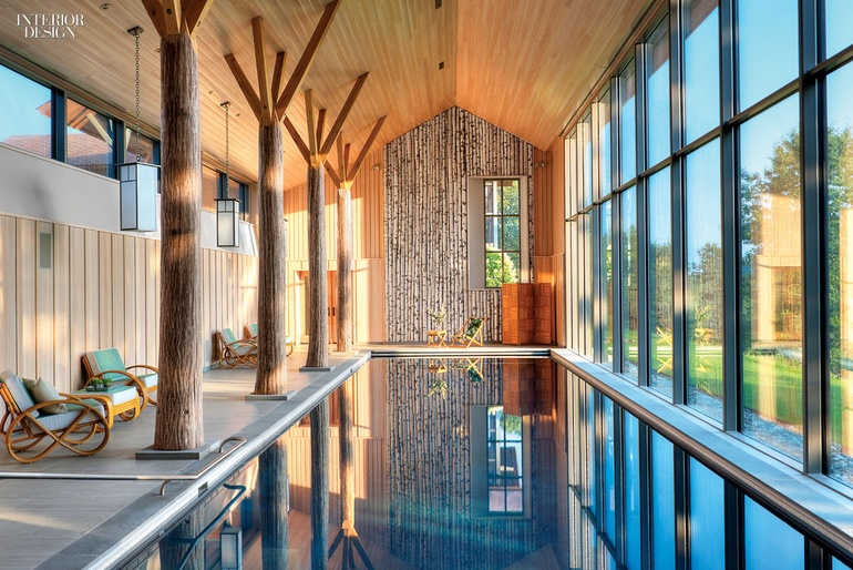 BarlisWedlick Architectsu0027 Pool House Has White Oak Columns That Stand  Alongside Vintage Paul Frankl Seating And Custom Reproductions.