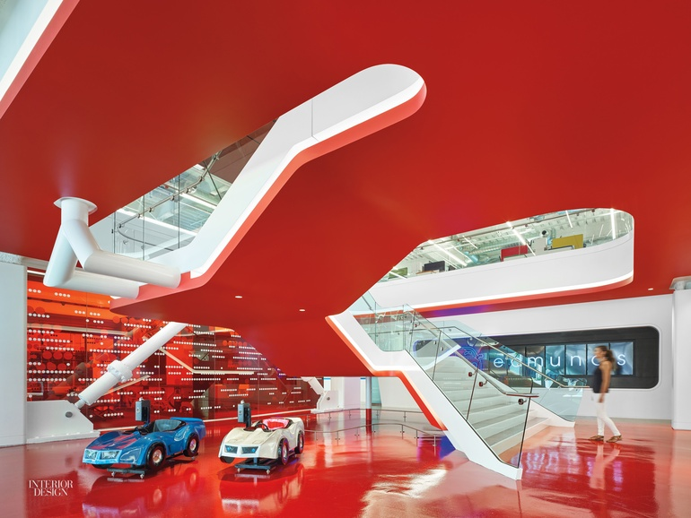 Slides and cars fill the bold hq by m m for High end interior designers los angeles