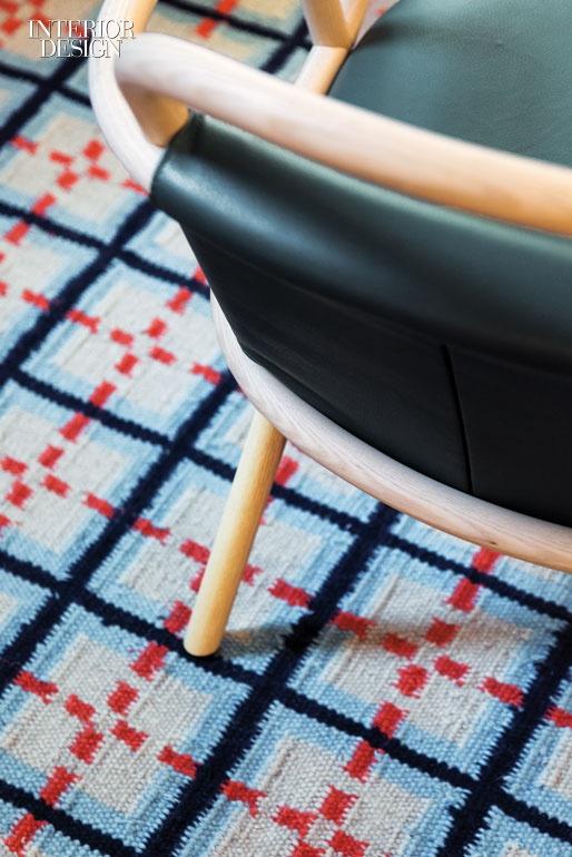 The lobby's rugs are custom. Photography by Patricia Parinejad.