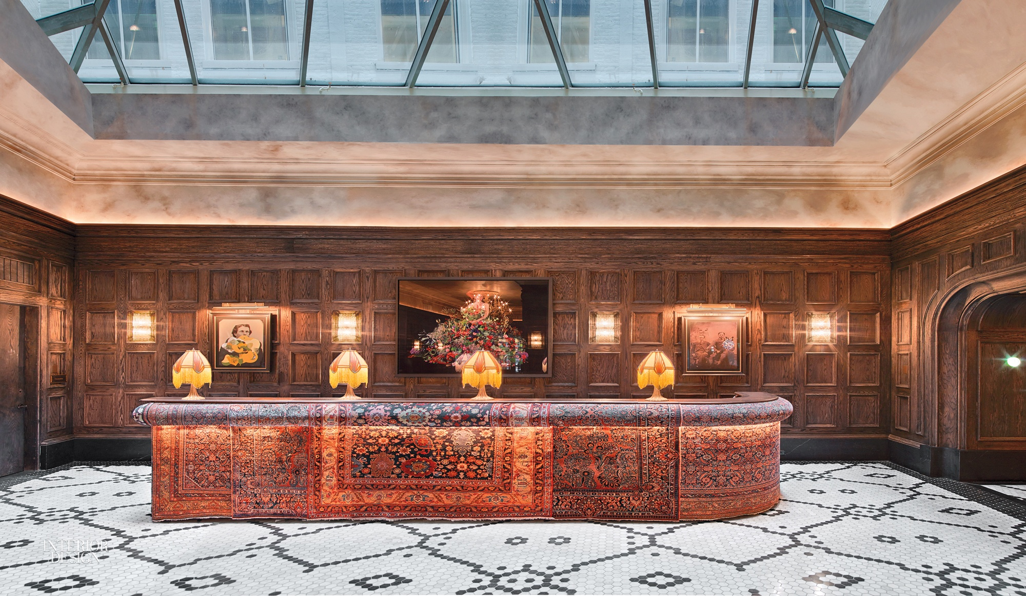 Persian wool rugs upholster the front of the reception desk. Photography by  Eric Laignel.