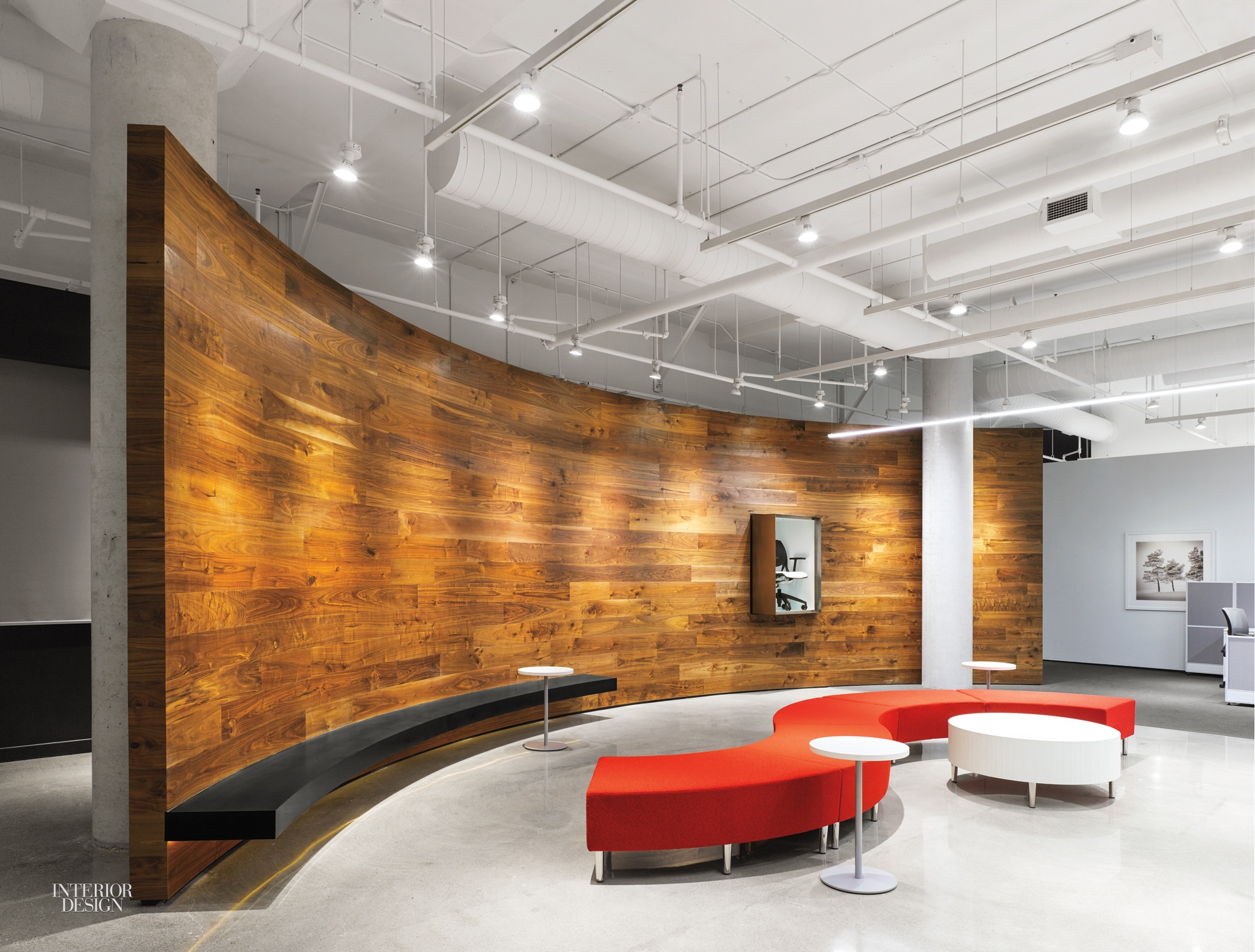 A Lounge At Global Furniture Groups Johnson Chou Designed Toronto Headquarters Is Bordered By Sweeping Wall Of Walnut