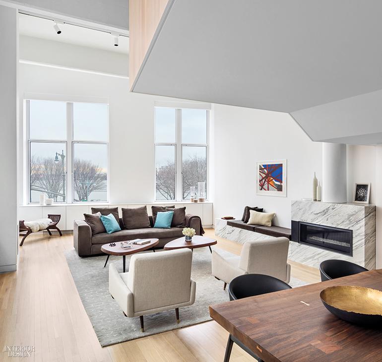 interior design for a living room. In this West Village duplex apartment by Joel Sanders Architect  Vermont marble wraps the living area s gas fireplace and attached banquette seating Residential Interior Design Projects