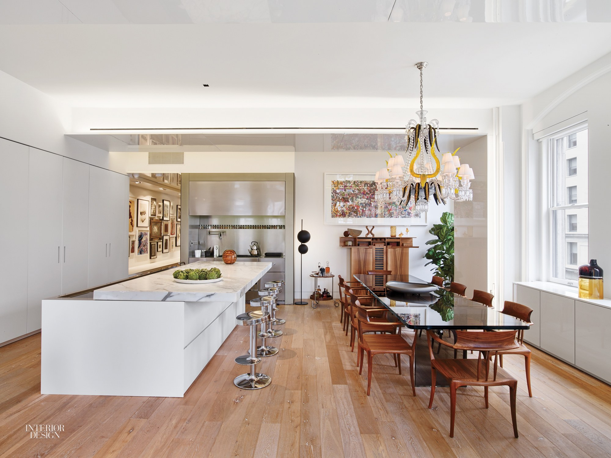 Awesome The Floor Is Distressed French Oak; The Kitchenu0027s Marble Counter Is Only A  Half Inch Thick, But Its Mitered Edge Makes It Look Massive.