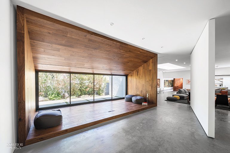 While Polished Concrete Flooring Flows Uninterrupted A Plasterboard Partition Pivots 360 Degrees To Separate The Rear Of Ground Level From Central